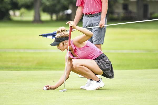 Katie Fyfe | The Journal Gazette  Casey Bunner prepares to putt on the 8th hole during the second round of Women's City Golf Tournament at Coyote Creek Golf Course on Saturday.