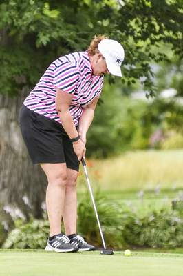 Katie Fyfe | The Journal Gazette  Lori Stinson putts on the 8th hole during the second round of Women's City Golf Tournament at Coyote Creek Golf Course on Saturday.