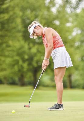 Katie Fyfe | The Journal Gazette  Brooke Moser putts on the green on the fifth hole during the second round of Women's City Golf Tournament at Coyote Creek Golf Course on Saturday.
