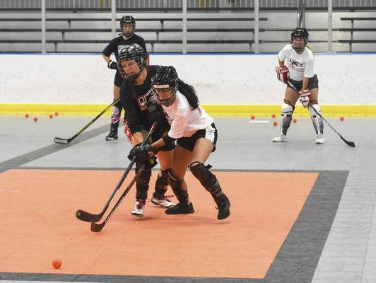Michelle Davies   The Journal Gazette Participants compete in a one tap drill at Saturday's tryouts for the Women's National Ball Hockey team at SportONE / Parkview Icehouse.
