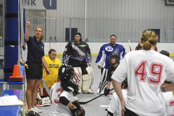 Michelle Davies   The Journal Gazette Assistant Coach Amber Moore points out stategy at Saturday's tryouts for the Women's National Ball Hockey team at SportONE / Parkview Icehouse.