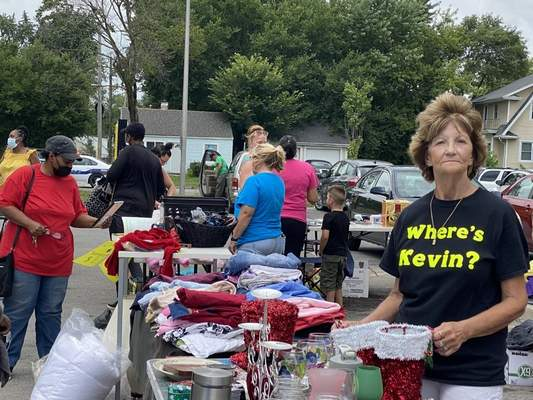 """Jamie Duffy   The Journal Gazette Dee Campbell, wearing a """"Where's Kevin?"""" T-shirt, hasn't given up on finding her grandson, Kevin Nguyen, in the nearly three years he's been missing. She supervised a parking lot sale Saturday to raise money for a $5,000 reward."""