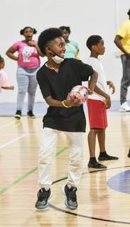 Katie Fyfe | The Journal Gazette Makhi Muff, 12, with the Euell A. Wilson Community Center, plays a game of dodge ball in a gym off Wabash Avenue Thursday. Part of the Wilson Center's mission is to promote an active, healthy lifestyle among the children it serves.