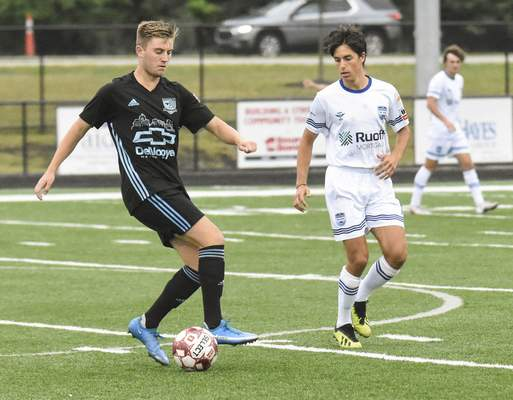 Michelle Davies | The Journal Gazette  Pep Casas, of Fort Wayne FC, right, keeps an eye on the ball as Kalamazoo FC's Daire O'Riordan works tomake a move in the first half of Sunday's game at Shields Field.