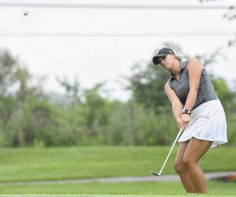 Michelle Davies   The Journal Gazette Emma Schroeder chips the ball onto the third green Sunday at Coyote Creek Golf Club during the final round of the Women's City Golf Tournament. Schroeder won by two shots.