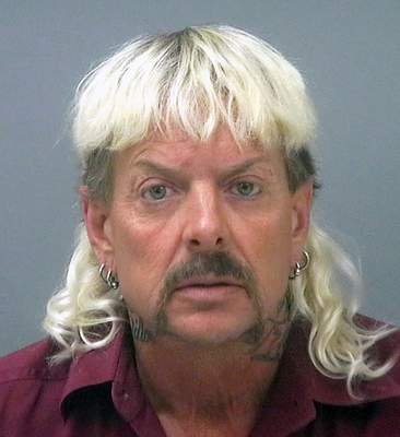 """FILE - This file photo provided by the Santa Rosa County Jail in Milton, Fla., shows Joseph Maldonado-Passage, also known as Joe Exotic. A federal appeals court ruled Wednesday, July 14, 2021, that """"Tiger King"""" Joe Exotic should get a shorter prison sentence for his role in a murder-for-hire plot and violating federal wildlife laws. (Santa Rosa County Jail via AP, File)"""