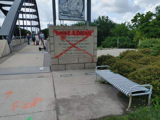 Courtesy Larry Gist The marker at the base of the Martin Luther King Jr. Memorial Bridge was vandalized Wednesday.