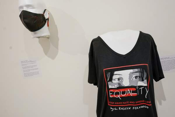 Stop Asian Hate T-shirt and mask by Rajeev Fernando are on display during the press preview of Responses: Asian American Voices Resisting the Tides of Racism at the Museum of Chinese in America, Wednesday, July 14, 2021, in New York. (AP Photo/Mary Altaffer)
