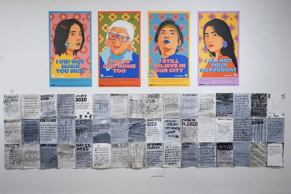 Posters created by the City of New York to combat Asian hate are on display during the press preview of Responses: Asian American Voices Resisting the Tides of Racism at the Museum of Chinese in America, Wednesday, July 14, 2021, in New York. (AP Photo/Mary Altaffer)