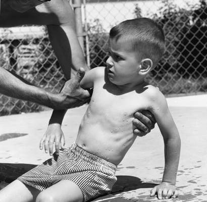 June 17, 1966: This boy doesn't seem all that enthused to go in the pool. (Journal Gazette file photo)
