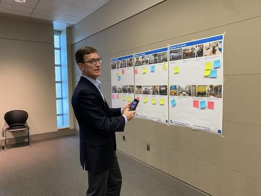Jamie Duffy   Journal Gazette  Rick Ortmeyer, a principal with Bostwick Design Partnership, took photos of the sticky notes for documentation in the Facilities Master Plan that will provide recommendations this year for library growth, expansion and renovation.