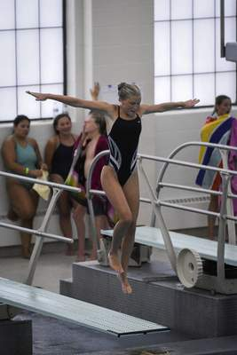 Mike Moore | The Journal Gazette Mercy Rhodenizer competes in the City Diving Meet at the Helen P. Brown Natatorium on Friday.