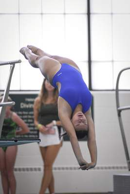 Mike Moore | The Journal Gazette Mary Villaruz competes in the City Diving Meet at the Helen P. Brown Natatorium on Friday.