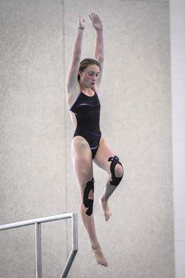 Mike Moore | The Journal Gazette Amelia Rinehart competes in the City Diving Meet at the Helen P. Brown Natatorium on Friday.