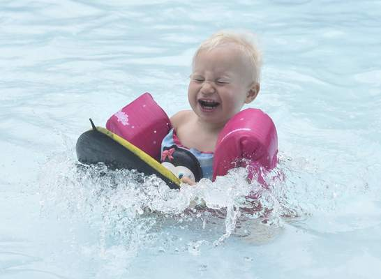 Michelle Davies | The Journal Gazette Joe White, 2, of Fort Wayne, plays in the kiddie pool Tuesday morning at Poco Pool.