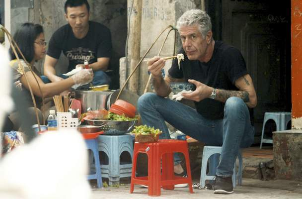 This image released by Focus Features shows Anthony Bourdain in Morgan Neville's documentary Roadrunner. (Focus Features via AP)