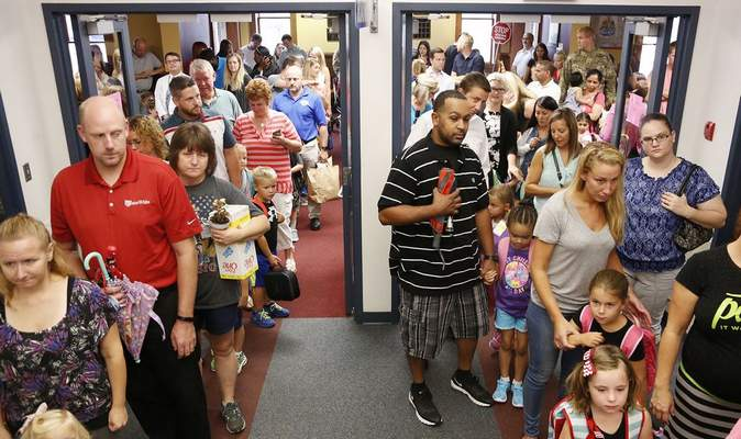 FILEKindergarten students at Whispering Meadows Elementary School line up with their parents on the first day of school.