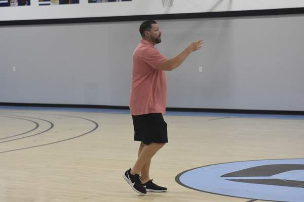 Dylan Sinn | The Journal Gazette  Fort Wayne Champs coach Steve Gansey, who coached the Mad Ants from 2015 to 2020, runs the Champs' first practice Thursday at the Ash Center. The Champs open The Basketball Tournament tonight.
