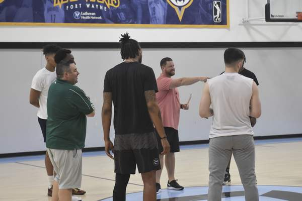 Dylan Sinn | The Journal Gazette  Fort Wayne Champs coach Steve Gansey, who coached the Mad Ants from 2015 to 2020, addressed the team at the Champs' first practice Thursday at the Ash Center. The Champs open The Basketball Tournament tonight.