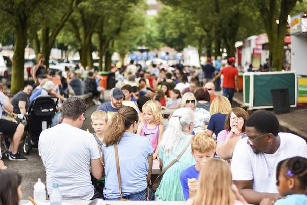 Katie Fyfe   The Journal Gazette Crowds gather  at Junk Food Alley in Headwaters Park on Saturday, the last day of the Three Rivers Festival.