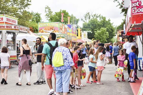 Katie Fyfe   The Journal Gazette  Crowds gather to enjoy some food at Junk Food Alley during Three Rivers Festival at Headwaters Park on Saturday.