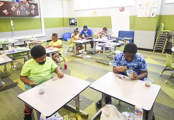 Katie Fyfe | The Journal Gazette Students do crafts at the Boys & Girls Clubs of Fort Wayne, which is partnering with Fort Wayne Community Schools this summer.