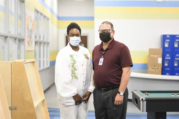 Katie Fyfe | The Journal Gazette  Suzanne Jones Brooks, a teacher at Jefferson Middle School and Matt Schiebel, Director for Secondary Education at FWCS, pictured at the Boys and Girls Club on Thursday, July 15th, 2021.