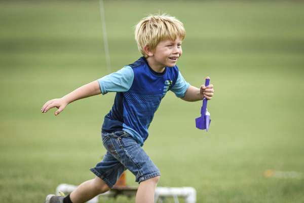 Mike Moore | The Journal Gazette Ryan Belcher, 6, sprints back to the launchpad Sunday after retrieving his rocket during a club meet for the Summit City Aerospace Modelers at the Concordia Theological Seminary.