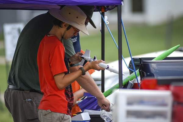 Mike Moore | The Journal Gazette Zach Braun, 13, preps a rocket for launch on Sunday during a club meet for the Summit City Aerospace Modelers at the Concordia Theological Seminary.