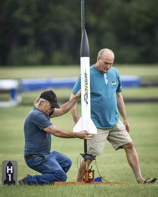 Mike Moore | The Journal Gazette Bob Jablonski, left and Gary Loy prep a rocket for launch Sunday during a club meet for the Summit City Aerospace Modelers at the Concordia Theological Seminary.