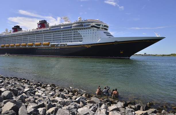 The Disney Dream sails out of Port Canaveral, Fla. on a two night test sailing, also known as a simulation cruise, Saturday, July 17, 2021. (Malcolm Denemark/Florida Today via AP)