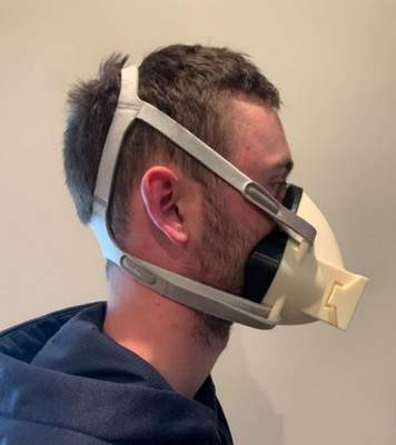 Brandon Bruman, a Trine University design engineering technology major, wears the final design for a 3D-printed respirator mask developed by his senior design team in partnership with Parkview Health.