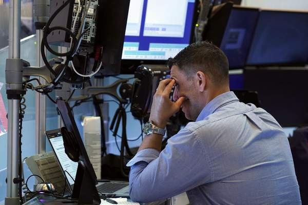 A trader works on the floor of the New York Stock Exchange, Monday, July 19, 2021. Stocks are falling sharply Monday as worries sweep from Wall Street to Sydney that the worsening pandemic in hotspots around the world will derail what's been a strong economic recovery. (AP Photo/Richard Drew)