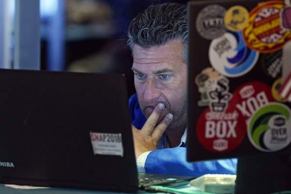 Trader Glenn Kessler works on the floor of the New York Stock Exchange, Monday, July 19, 2021. Stocks are falling sharply Monday as worries sweep from Wall Street to Sydney that the worsening pandemic in hotspots around the world will derail what's been a strong economic recovery. (AP Photo/Richard Drew)