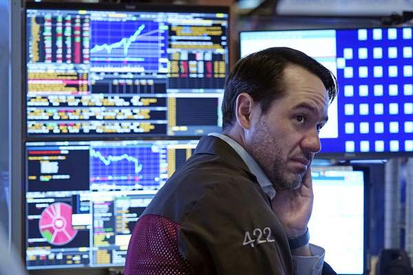 A trader works in a booth on the floor of the New York Stock Exchange, Monday, July 19, 2021. (AP Photo/Richard Drew)