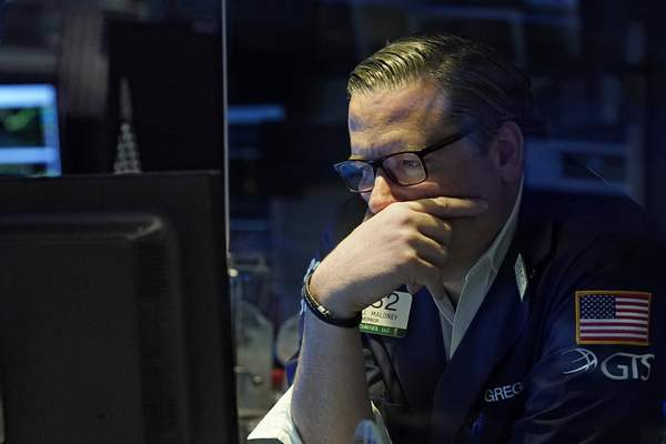 Specialist Gregg Maloney works on the floor of the New York Stock Exchange, Monday, July 19, 2021. (AP Photo/Richard Drew)