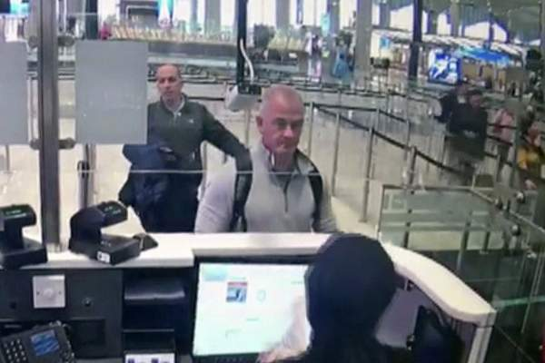 FILE †This Dec. 30, 2019, image from security camera video shows Michael L. Taylor, center, and George-Antoine Zayek at passport control at Istanbul Airport in Turkey. A Tokyo court handed down prison terms for the American father Michael Taylor and son Peter accused of helping Nissan's former chairman, Carlos Ghosn, escape to Lebanon while awaiting trial in Japan.(DHA via AP, File)