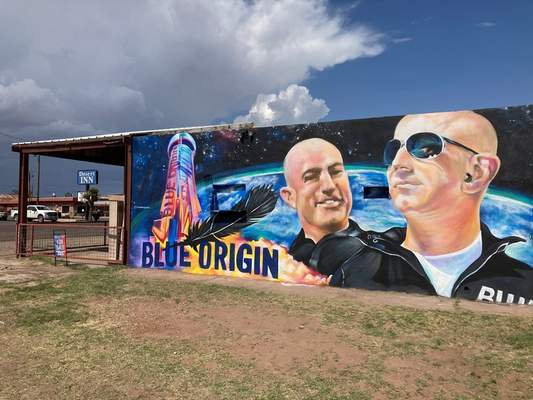Associated Press The side of a building in Van Horn, Texas, is adorned with a mural of Blue Origin founder Jeff Bezos, who will launch into space today from the spaceport about 25 miles from the West Texas town.