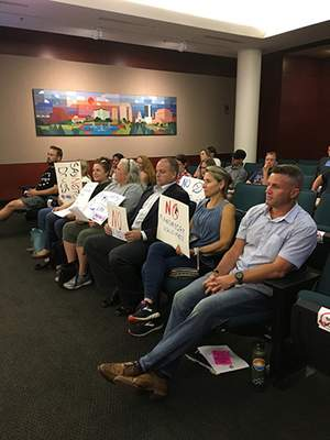 Photo by Rosa Salter Rodriguez | The Journal Gazette More than a dozen residents attended the Allen County Board of Health's meeting tonight with signs indicating their opposition to mandated vaccines and face masks.