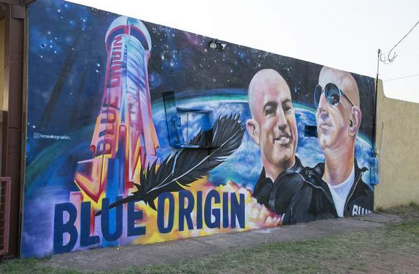 A mural by Fernandezgraphics of Blue Origin and Amazon founder Jeff Bezos is seen on the wall of a building Tuesday in Van Horn, Texas. (Jacob Ford/Odessa American via AP)