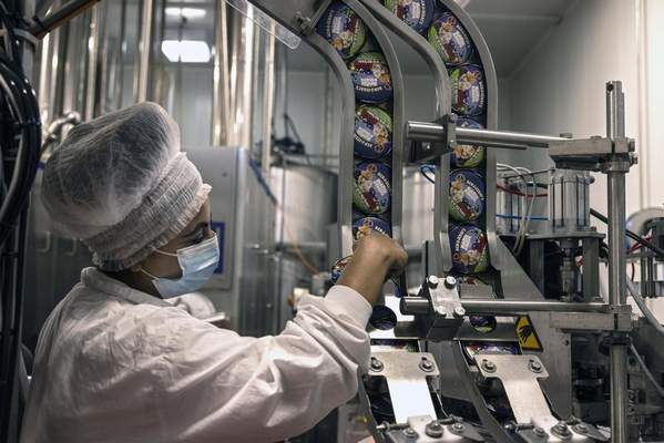 An Israeli works at the Ben & Jerry's ice-cream factory in the Be'er Tuvia Industrial area, Tuesday, July 20, 2021. (AP Photo/Tsafrir Abayov)