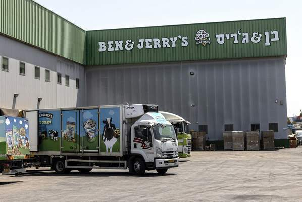 Truck are parked at the Ben & Jerry's ice-cream factory in the Be'er Tuvia Industrial area, Tuesday, July 20, 2021. (AP Photo/Tsafrir Abayov)