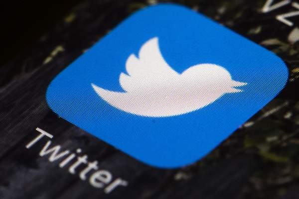 FILE - In this April 26, 2017, file photo is a Twitter app icon on a mobile phone in Philadelphia. Twitter is giving Rep. Marjorie Taylor Greene a 12-hour timeout, saying some of her tweets violated its policy against coronavirus misinformation. (AP Photo/Matt Rourke, File)