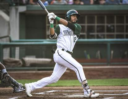 Mike Moore | The Journal Gazette TinCaps right fielder Agustin Ruiz takes a cut in the first inning Tuesday at Parkview Field.