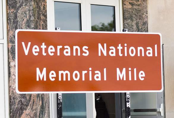 Katie Fyfe   The Journal Gazette  The unveiling of the Veterans Memorial Mile takes place at the Allen County Memorial Coliseum Veterans Plaza on Wednesday.