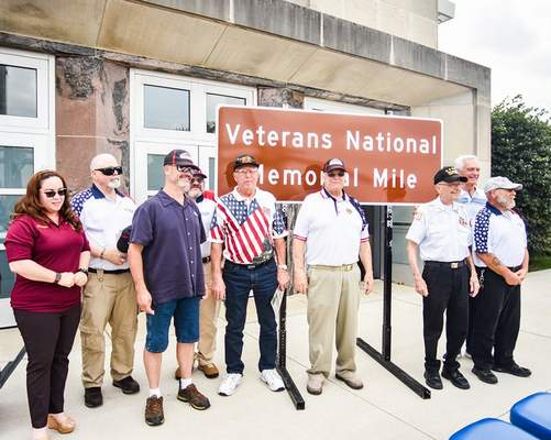 Katie Fyfe   The Journal Gazette  Veterans pose together after the unveiling of the Veterans Memorial Mile at the Allen County Memorial Coliseum Veterans Plaza on Wednesday.