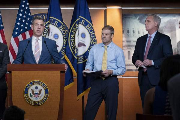 Rep. Jim Banks, R-Ind., speaks during a news conference as Rep. Jim Jordan, R-Ohio, and House Minority Leader Kevin McCarthy, R-Calif., looks on at Capitol Hill, in Washington, Wednesday, July 21, 2021. (AP Photo/Jose Luis Magana)