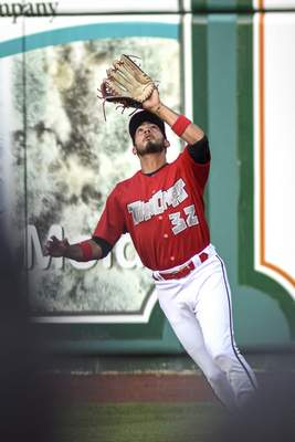 Mike Moore | The Journal Gazette TinCaps right fielder Agustin Ruiz catches a pop fly in the first inning against Dayton on Wednesday.