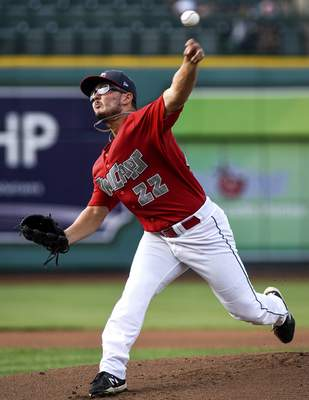 Mike Moore | The Journal Gazette TinCaps pitcher Danny Denz reads the pitch in the first inning against the Dragons on Wednesday.