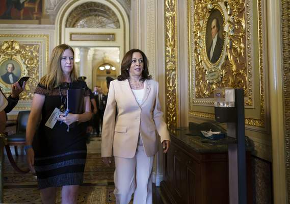 Vice President Kamala Harris arrives at the Senate to break any tie votes as the Senate prepares to hold a procedural vote on infrastructure, at the Capitol in Washington, Wednesday, July 21, 2021. (AP Photo/J. Scott Applewhite)